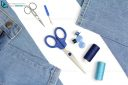 Tailor's tools for sewing with jeans and  scissors acut-out on white background