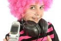Young girl  with pink hair shows her old cellphone