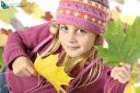 Autumnal mood of  happy girl with autumn leaves