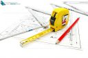 Architect work tools equipment on blueprint construction with measuring tape, pencil and wooden ruler.