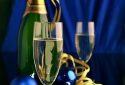 champagne and gold ribbon on dark background