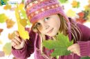 Autumnal mood of happy girl in yellow autumn leaves