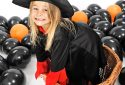 funny young girl in witch costume for Halloween
