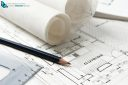 kitchen renovation plans with rolled up house plans, pencil and triangular ruler.