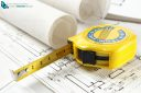 Construction plan with tape measure close-up