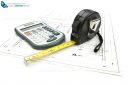 Architectural project concept with tape measure and calculator on construction project drawing plan