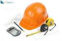 Construction safety helmet posing on paper blueprints, tape measure, pencil and calculator, isolated on white background