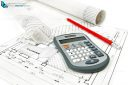 Calculator and pencil on house plan with rolls of architectural drawings