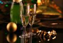 Close up of a bottle of champagne with two glasses and christmas ball
