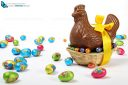 basket with a chocolate Easter hen , yellow ribbon and eggs, isolated on white background