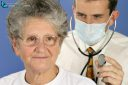Doctor with stethoscope examines sick 65 year old patient in consultation